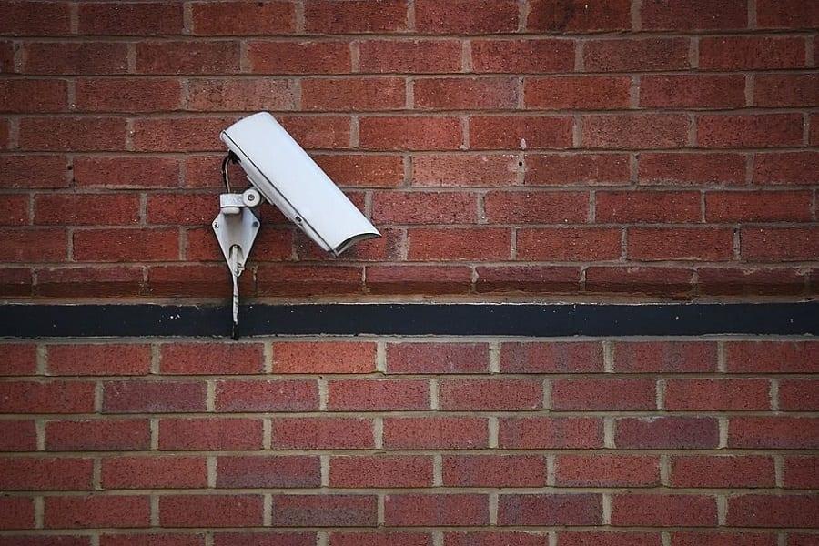 fake camera on brick wall